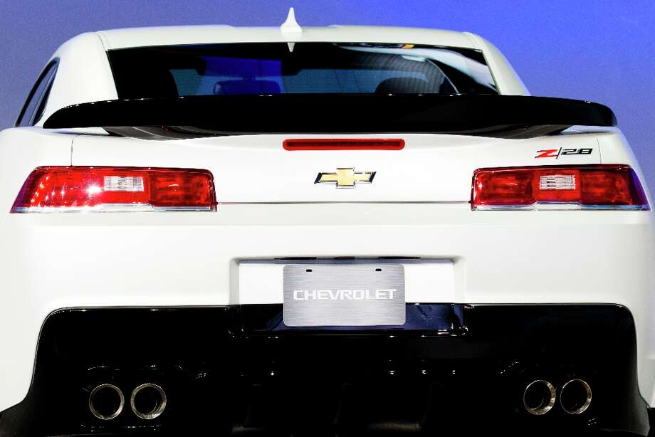 The 2014 Chevrolet Camaro Z28 is unveiled during the New York International Auto Show. Chevrolet brought back the classic 1967 racing legend that's specifically targeted at sports car enthusiasts. Photo: John Minchillo, Associated Press / FR170537 AP