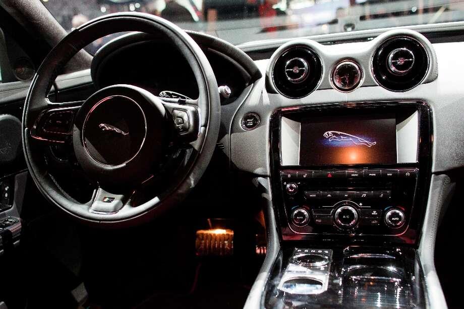 The 2014 Jaguar XJ L-R is unveiled during the New York International Auto Show. Photo: John Minchillo, Associated Press / FR170537 AP