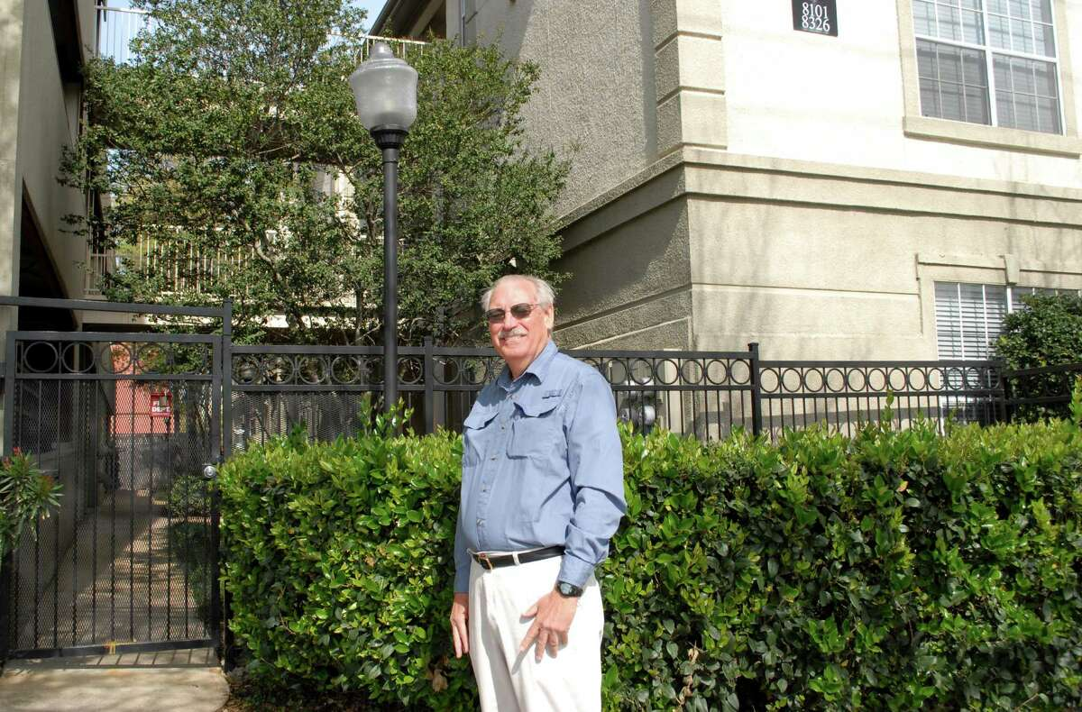Historian Louis Aulbach stands at what was once the main entrance of the former state fairgrounds in Midtown.