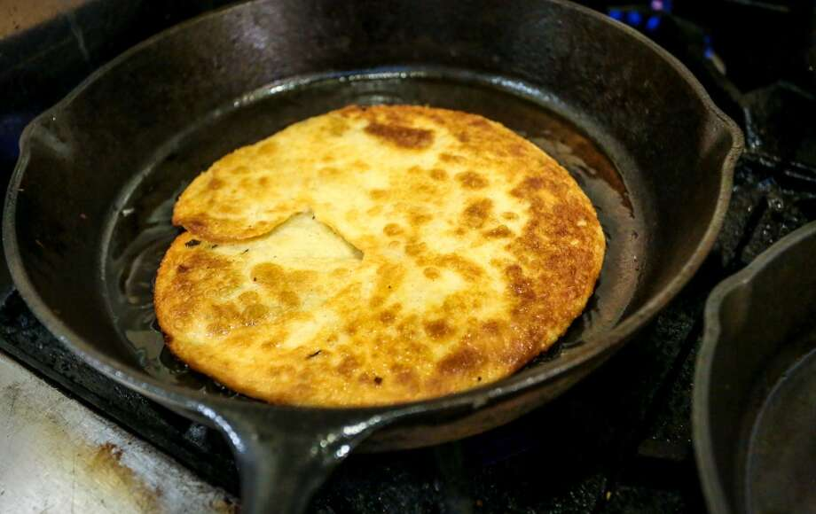 Scallion Pancake cooks in a cast iron pan at Shanghai Winter Garden in Millbrae.