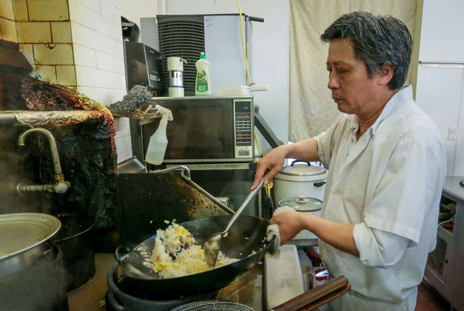 Chef Shao Shan Sun cooks fried rice.