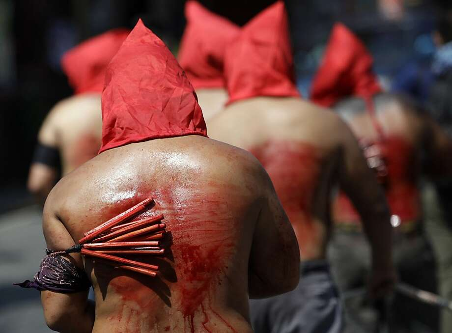 Maundy, bloody Maundy: Hooded penitents flagellate themselves to atone for their sins on Maundy Thursday in suburban Mandaluyong, Philippines. The ritual is frowned upon by church leaders in the predominantly Roman Catholic country. Photo: Aaron Favila, Associated Press
