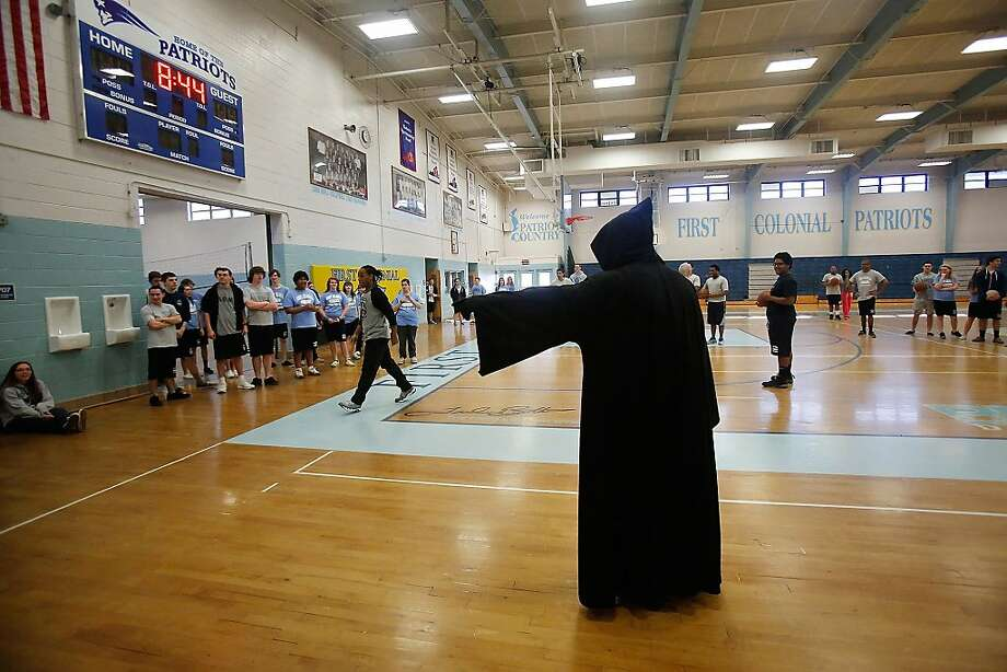 Coach is in a bad mood today: Officer John Vanderheiden II portrays the Grim Reaper in a role-playing program at First Colonial High School in Virginia Beach, Va. The idea is to impress junior and senior students of the sometimes fatal consequences of making bad decisions in regard to teenage drinking and personal safety. Photo: Hyunsoo Leo Kim, Associated Press