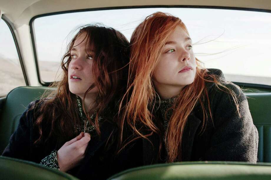Rosa (Alice Englert) and Ginger (Elle Fanning) take different approaches to dealing with a major crisis. Photo: Nicola Dove, Handout / ONLINE_YES