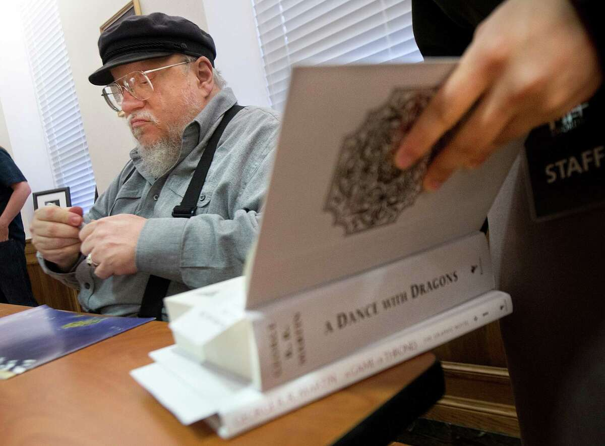 Author George R.R. Martin signs copies of his works at Texas A&M University.PHOTOS: 'Game of Thrones' characters out of costume