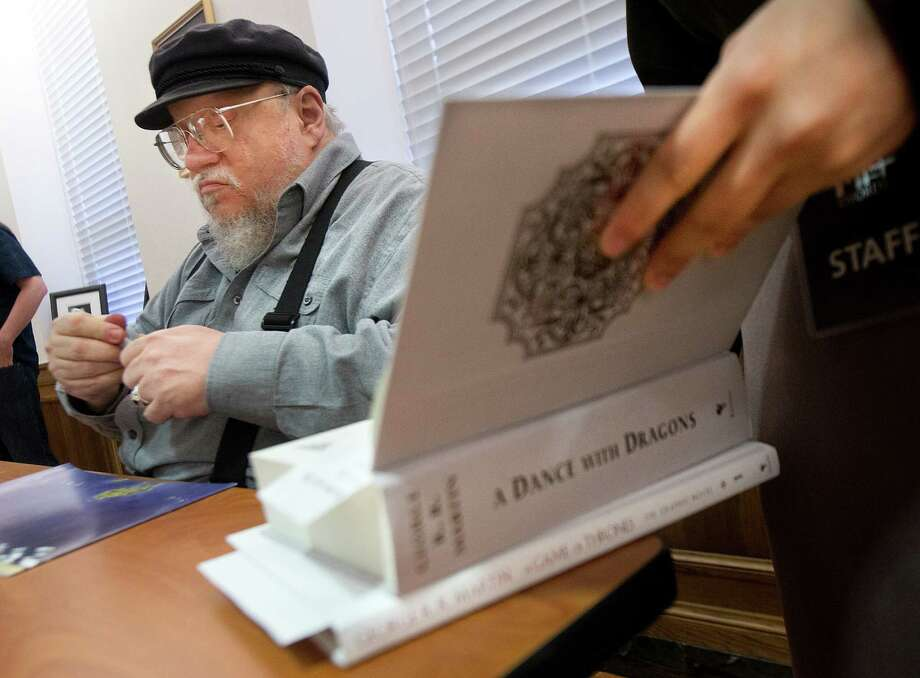 Author George R.R. Martin signs copies of his works at Texas A&M University. Photo: Stuart Villanueva
