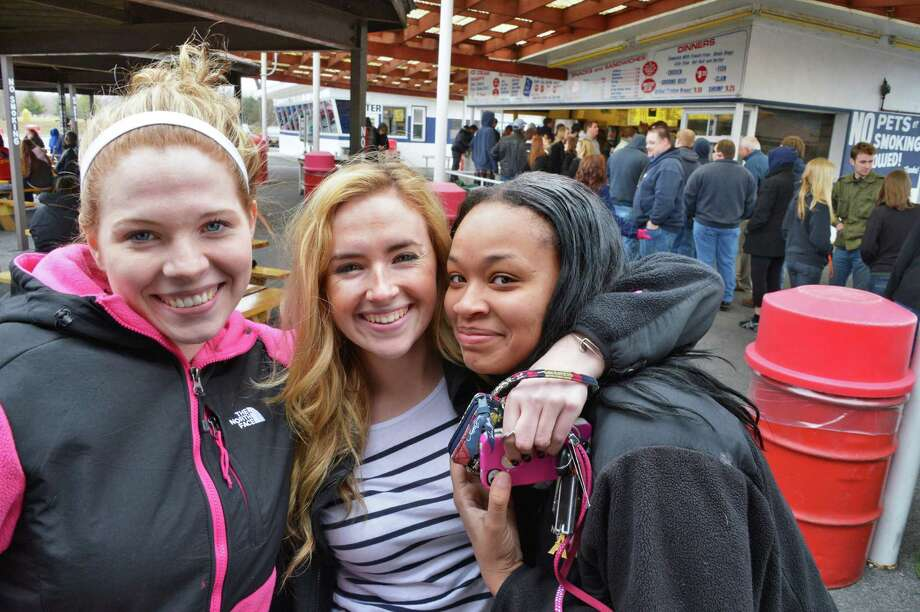 Niskayuna High seniors, from left, Mackenzie Jones, Chloe Bellcourt and Janajah Frazier pose for a photo as they wait on queue as Jumpin' Jack's Drive-In in Scotia opens for the season Thursday March 28, 2013.  (John Carl D'Annibale / Times Union) Photo: John Carl D'Annibale / 10021452A