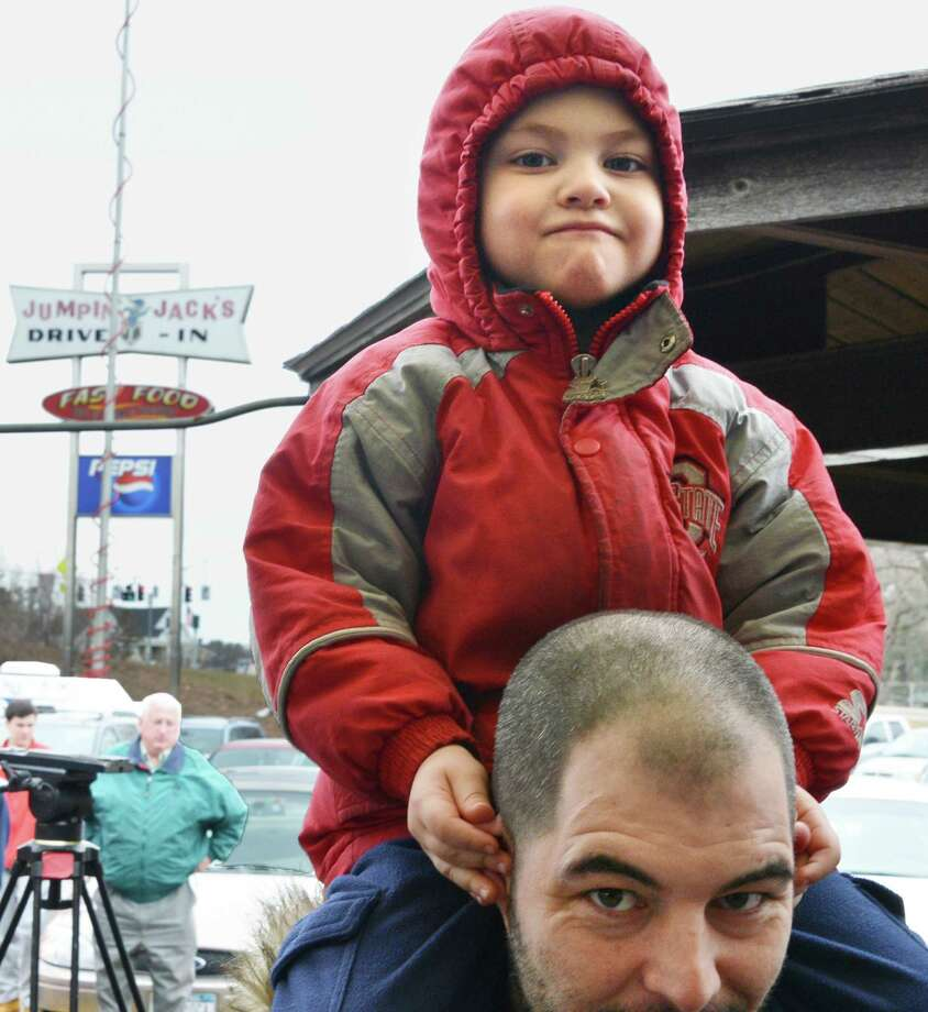Four-year-old Sean Savary of Boston rides on his dad, Billy Savary's shoulders as they wait in line as Jumpin' Jack's Drive-In in Scotia opens for the season Thursday March 28, 2013.  (John Carl D'Annibale / Times Union) Photo: John Carl D'Annibale / 10021452A