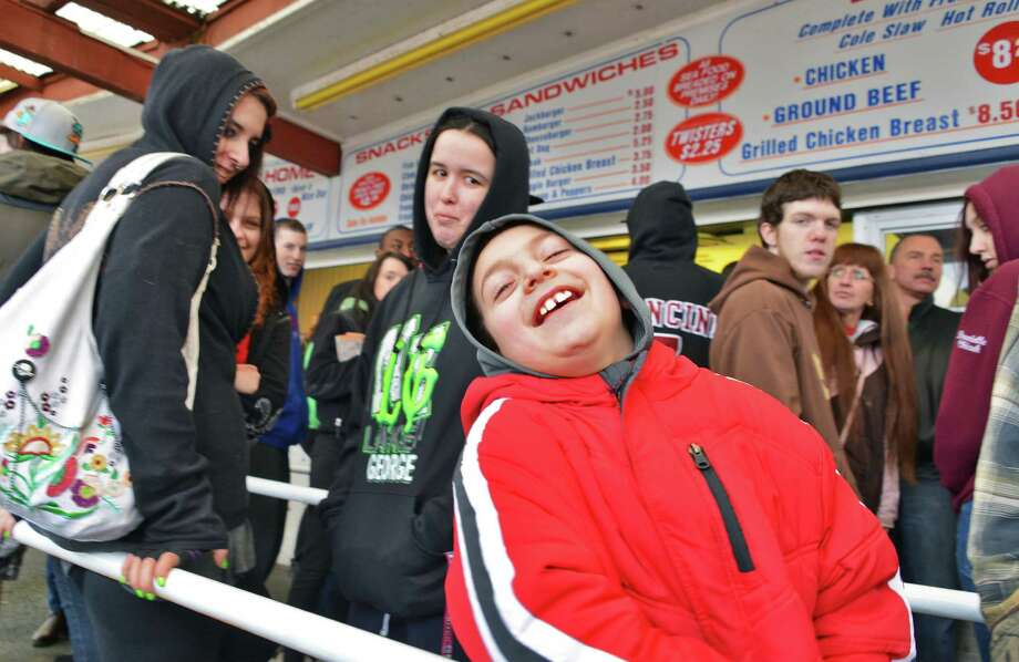 Eight-year-old Ryan Russo of Scotia doesn't seem to mind waiting in line as Jumpin' Jack's Drive-In in Scotia opens for the season Thursday March 28, 2013.  (John Carl D'Annibale / Times Union) Photo: John Carl D'Annibale / 10021452A