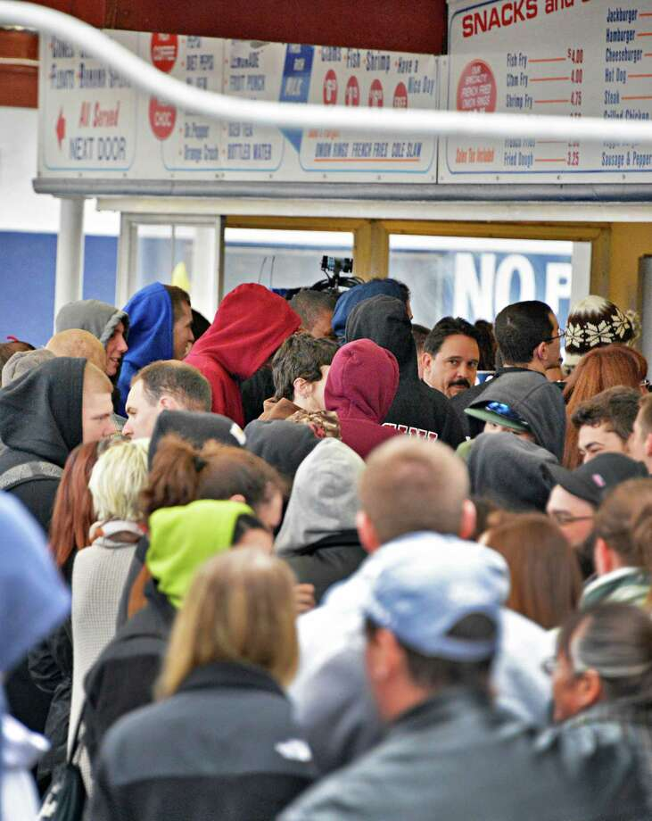 Customers brave cold and damp as Jumpin' Jack's Drive-In in Scotia opens for the season Thursday March 28, 2013.  (John Carl D'Annibale / Times Union) Photo: John Carl D'Annibale / 10021452A