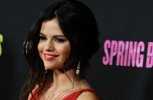 "Selena Gómez llega al estreno de ""Spring Breakers"" en el Teatro ArcLight de Hollywood, el jueves 14 de marzo del 2013. (Foto por Jordan Strauss/Invision/AP) Photo: Jordan Strauss, Associated Press / Invision"