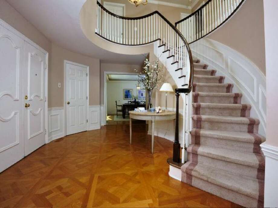 Foyer with stairs leading up to second level