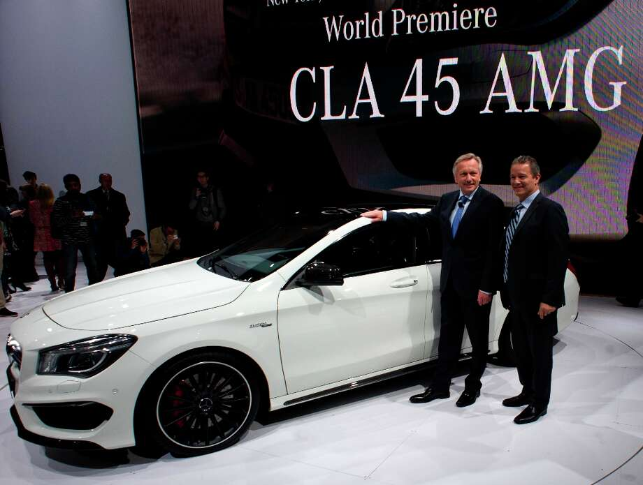 Officials from Mercedes-Benz introduce the new CLA 45 AMG during a media conference at the New York International Auto Show. The 113th New York International Auto Show, which runs through April 7, features 1,000 vehicles as well the latest in tech, safety and innovation. Photo: DON EMMERT, AFP/Getty Images / 2013 AFP