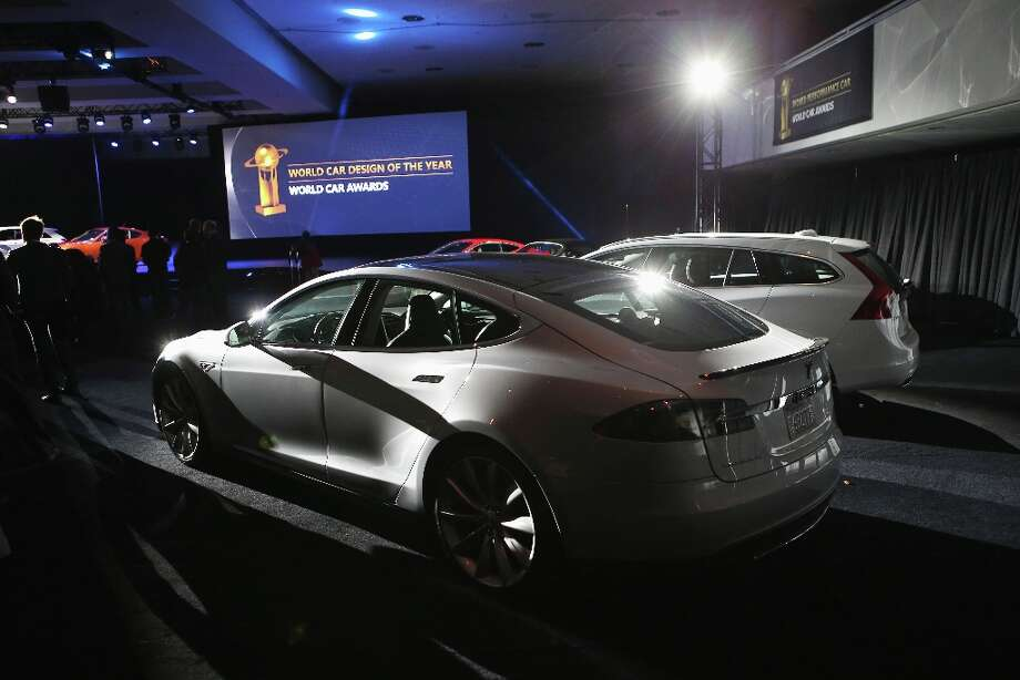 A Tesla Model S is displayed after winning the 2013 World Green Car of the Year award at the New York Auto Show. It was chosen from an original entry list of 21 vehicles from all over the world. Photo: John Moore, Getty Images / 2013 Getty Images