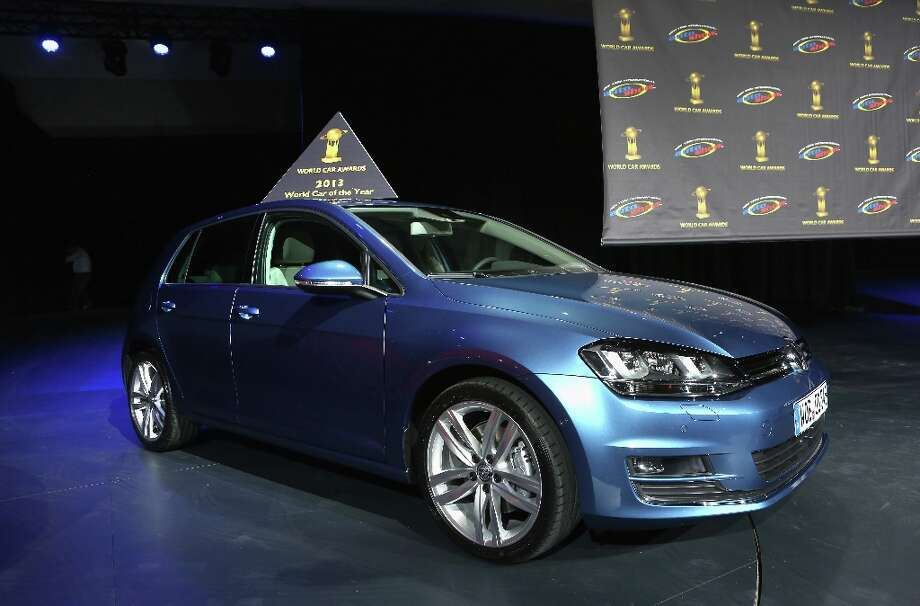 A Volkswagen Golf is displayed after being named the 2013 World Car of the Year at the New York Auto Show. It was the second consecutive year that Volkswagen has won the prestigious title. Photo: John Moore, Getty Images / 2013 Getty Images