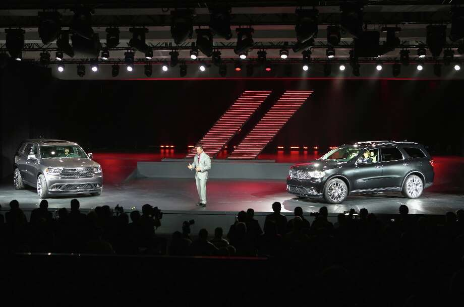 Reid Bigland, the CEO of Dodge and head of U.S. sales for Chrysler introduces the 2014 Dodge Durango RT (L), and the Dodge Durango Citadel to the media at the New York Auto Show. Photo: John Moore, Getty Images / 2013 Getty Images