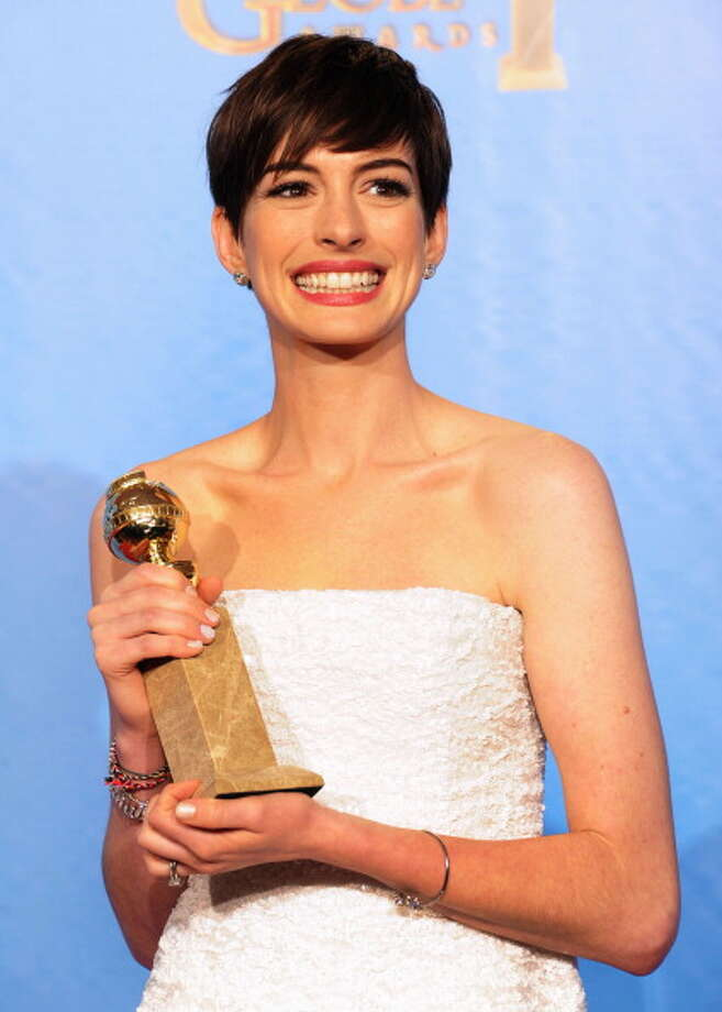 AH posing with her Golden Globe. Photo: Kevin Winter, Getty Images / 2013 Getty Images