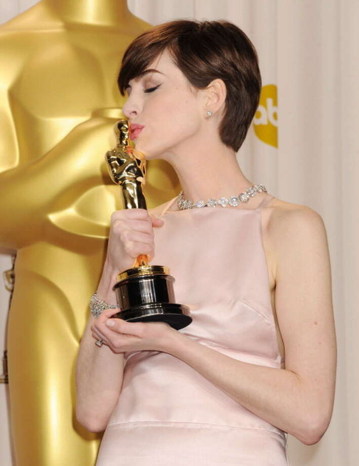 Anne Hathaway expresses her happiness at winning the Oscar. Photo: Jeffrey Mayer, WireImage / 2013 Jeffrey Mayer
