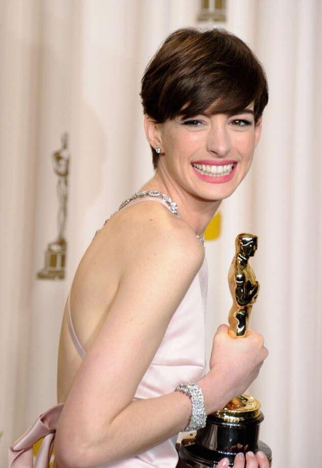 Backstage with her Oscar. Exuding happiness. Photo: Steve Granitz, WireImage / 2013 Steve Granitz