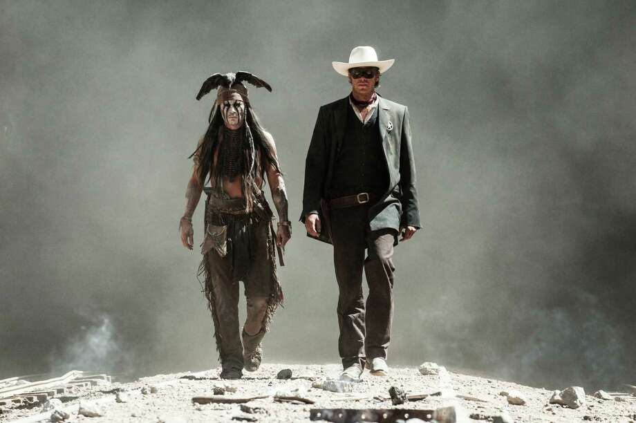 "This undated publicity photo released by Disney/Bruckheimer Films shows, from left, Johnny Depp as Tonto and Armie Hammer as The Lone Ranger, in a scene from the movie, ""The Lone Ranger,"" directed by Gore Verbinski. The film opens nationwide on July 3, 2013. (AP Photo/Disney/Bruckheimer Films, Peter Mountain) Photo: Peter Mountain"