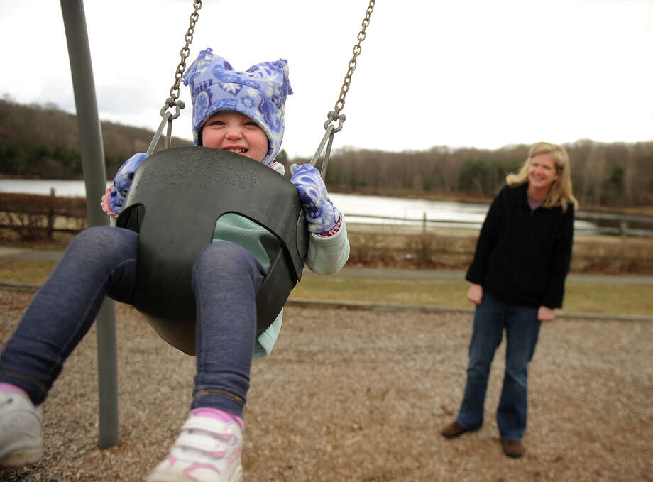 Eliana McEvoy, 2, and Leanne McEvoy, of Monroe, enjoy an afternoon on the swings at Wolfe Park in Monroe on Thursday, March 28, 2013. Photo: Brian A. Pounds / Connecticut Post