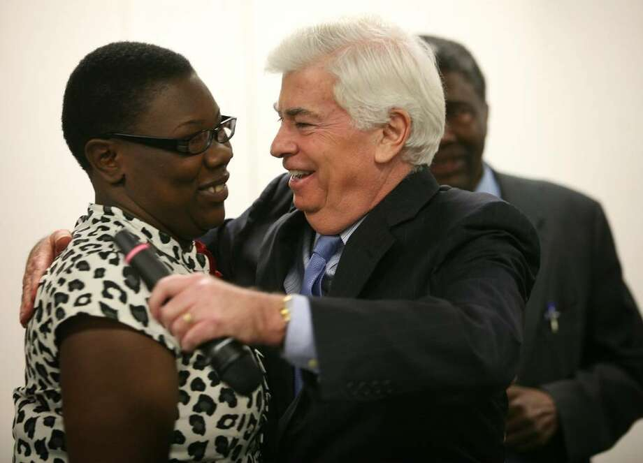 Home heating assistance recipient Shaunette James of Bridgeport receives a hug from Sen. Christopher Dodd after telling her story at a home heating assistance press conference at ABCD in Bridgeport on Tuesday. Photo: Brian A. Pounds / Connecticut Post