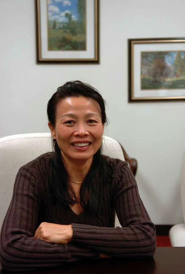 Helen Wu, a tuberculosis case worker at the Bridgeport Health Department, has been cited for winning the 2009 New England TB Hero award. Here, she poses at the health department in Bridgeport on Tuesday Jan. 05, 2010. Photo: Christian Abraham / Connecticut Post