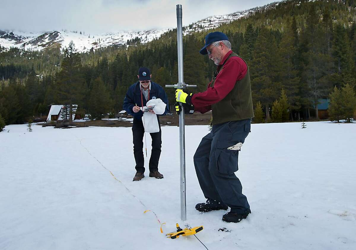 State Department of Water Resources officials Keith Swanson, left, and Frank Gehrke take snow samples at Phillips Station in El Dorado county on Thursday, March 28, 2013. Snow surveyors reported that water content in California?•s snowpack is only 52 percent of normal.(Randall Benton / The Sacramento Bee)
