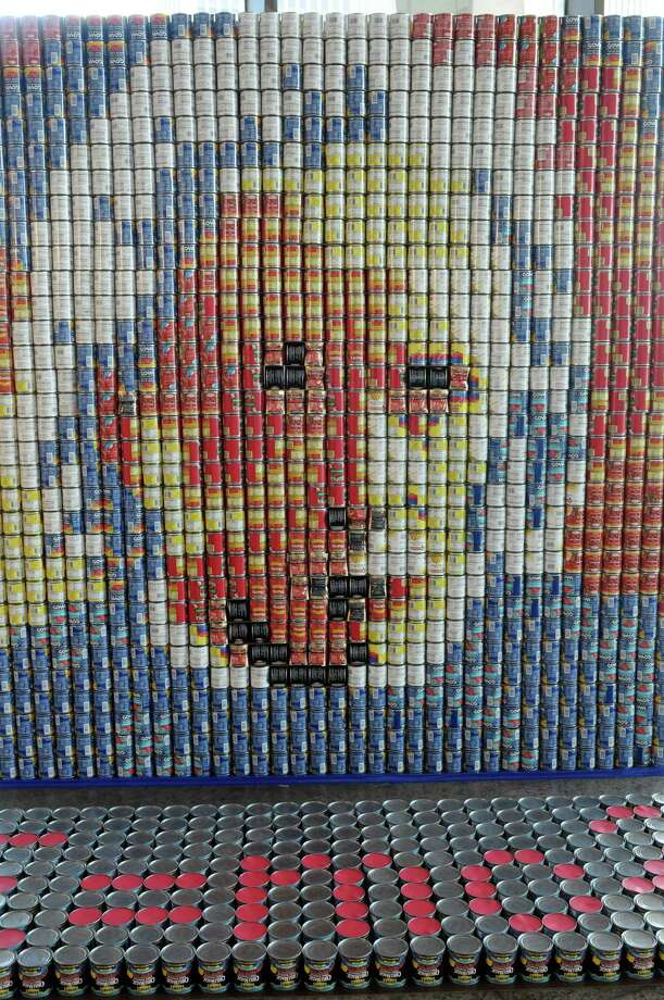 "A sculpture part of the CANstruction show at the State Museum titled, ""Can you imagine AN END TO HUNGER?"" is seen on the fourth floor of the museum on Wednesday, March 27, 2013 in Albany, NY.  The sculpture is a portrait of Albert Einstein and is made out of 717 cans of corned beef hash, 2,506 cans of tomato sauce, 204 cans of garbanzo beans and 290 cans of chili.   (Paul Buckowski / Times Union) Photo: Paul Buckowski"