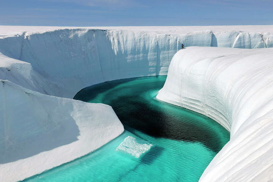 "This 2009 photo released by Extreme Ice Survey shows Birthday Canyon in Greenland furing the filming of ""Chasing Ice."" The film, about climate change, follows National Geographic photographer James Balog across the Arctic as he deploys revolutionary time-lapse cameras designed to capture a multi-year record of the world's changing glaciers. (AP Photo/Extreme Ice Survey, James Balog) Photo: James Balog / Extreme Ice Survey"
