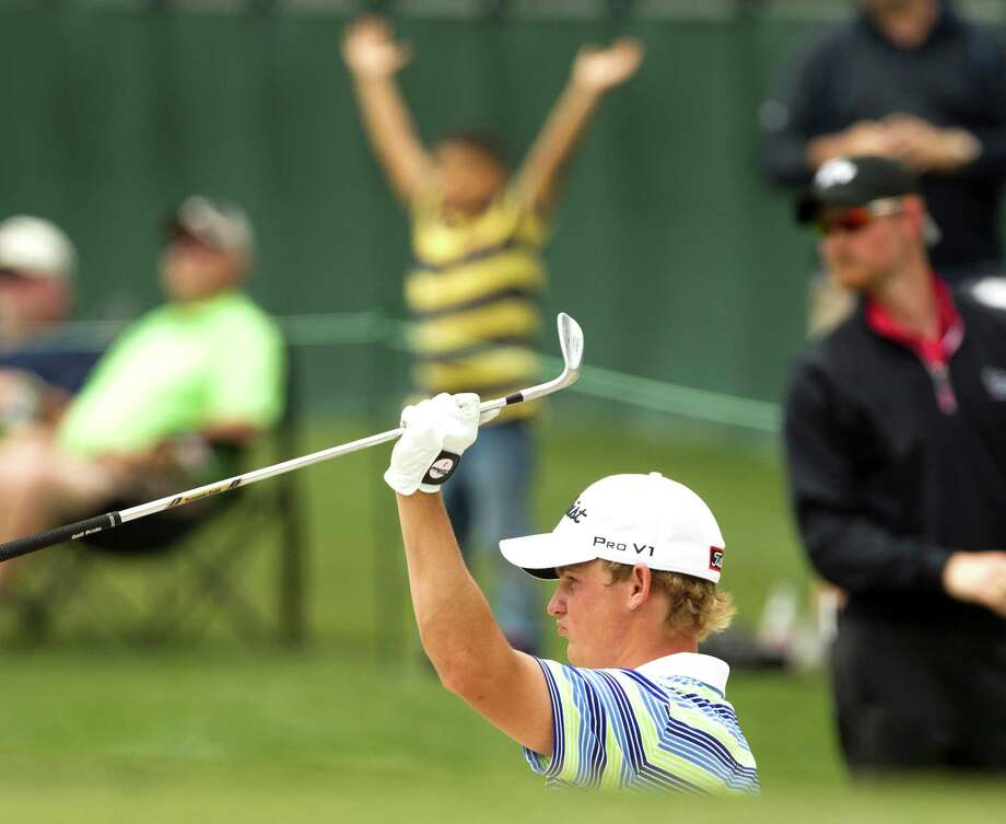 Bud Cauley reacts after holing out from the bunker on No. 16 during the first round of the Shell Houston Open at the Redstone Tournament Course Thursday, March 28, 2013, in Humble. Photo: Brett Coomer, Houston Chronicle / © 2013 Houston Chronicle