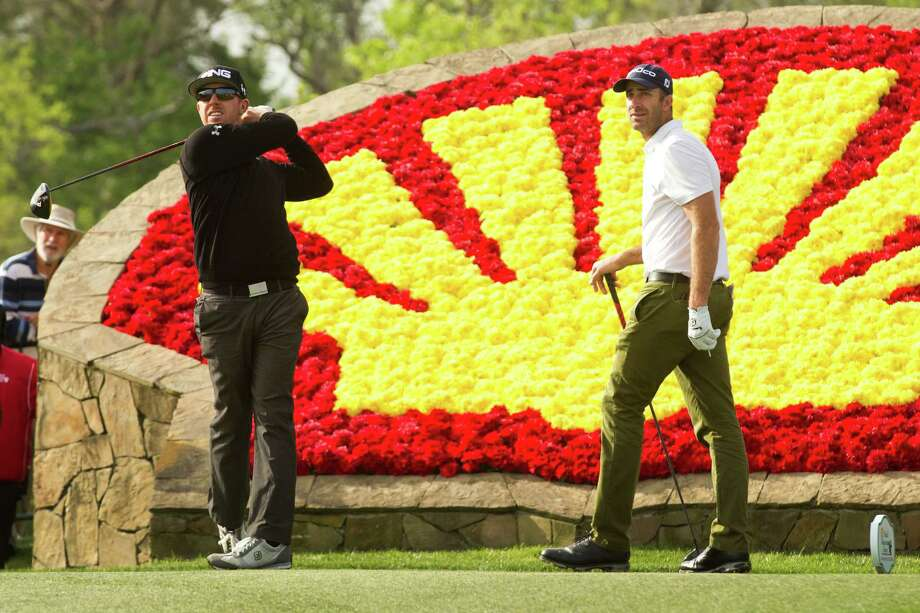 Hunter Mahan, left, watches his tee shot on No. 18 as Geoff Ogilvy walks onto the tee box during the first round. Photo: Brett Coomer, Houston Chronicle / © 2013 Houston Chronicle