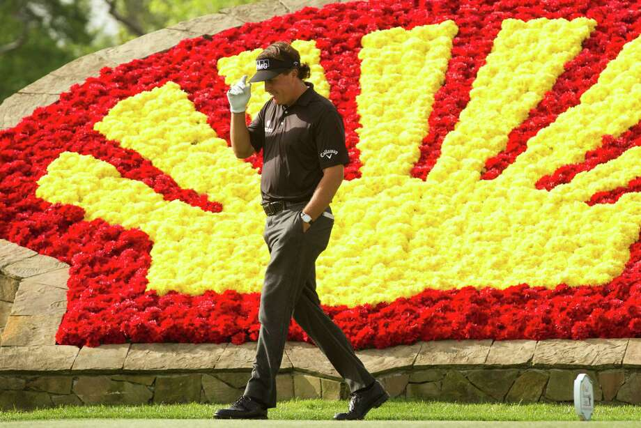 Phil Mickelson tips his cap as he walks onto the tee box on No. 18 during the first round of the Shell Houston Open at the Redstone Tournament Course Thursday, March 28, 2013, in Humble. Photo: Brett Coomer, Houston Chronicle / © 2013 Houston Chronicle