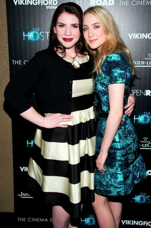 Author Stephenie Meyer, left, and Saoirse Ronan attend a screening of The Host presented by The Cinema Society and Jaeger-LeCoultre on Wednesday, March 27, 2013 in New York. (Photo by Charles Sykes/Invision/AP) Photo: Charles Sykes, Associated Press / Invision