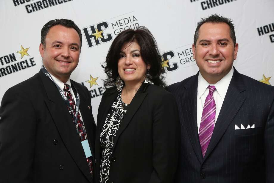 From left to right, Ruben Mercado, Veronica Mosquedo and Ben Mendez pose for photos after the Hispanic Chamber Luncheon at the  Hilton America Hotel in Houston, Texas. Photo: Thomas B. Shea, Houston Chronicle / © 201c Thomas B. Shea
