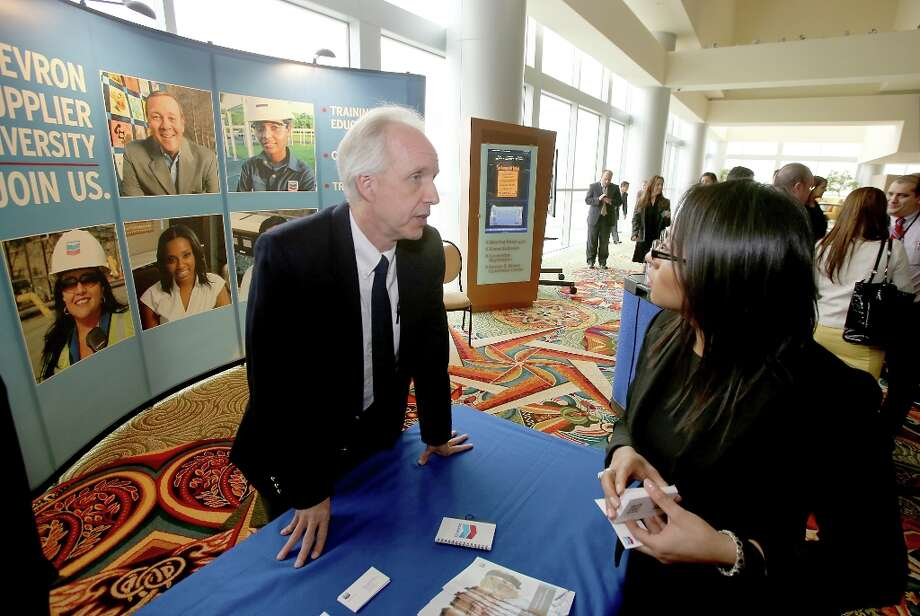 Ron Rodrigues with Chevron talks with Glendys Rodriguez with national University at the expos at the Houston Hispanic Chamber of Commerce Luncheon at the Hilton America Hotel in Houston, Texas. Photo: Thomas B. Shea, Houston Chronicle / © 201c Thomas B. Shea