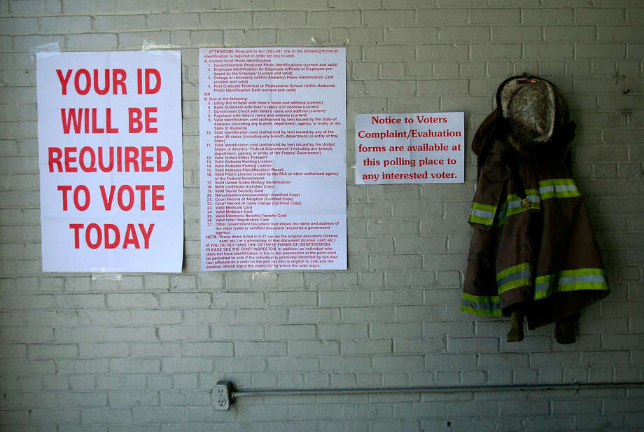 Voting signs are posted before the November 2008 presidential election in a firehouse in Selma, Ala.  Selma was a touchstone in the civil rights movement where Martin Luther King Jr. led marches that eventually led to the Voting Rights Act of 1965, ending voter disfranchisement against African Americans. Photo: Getty Images File Photo