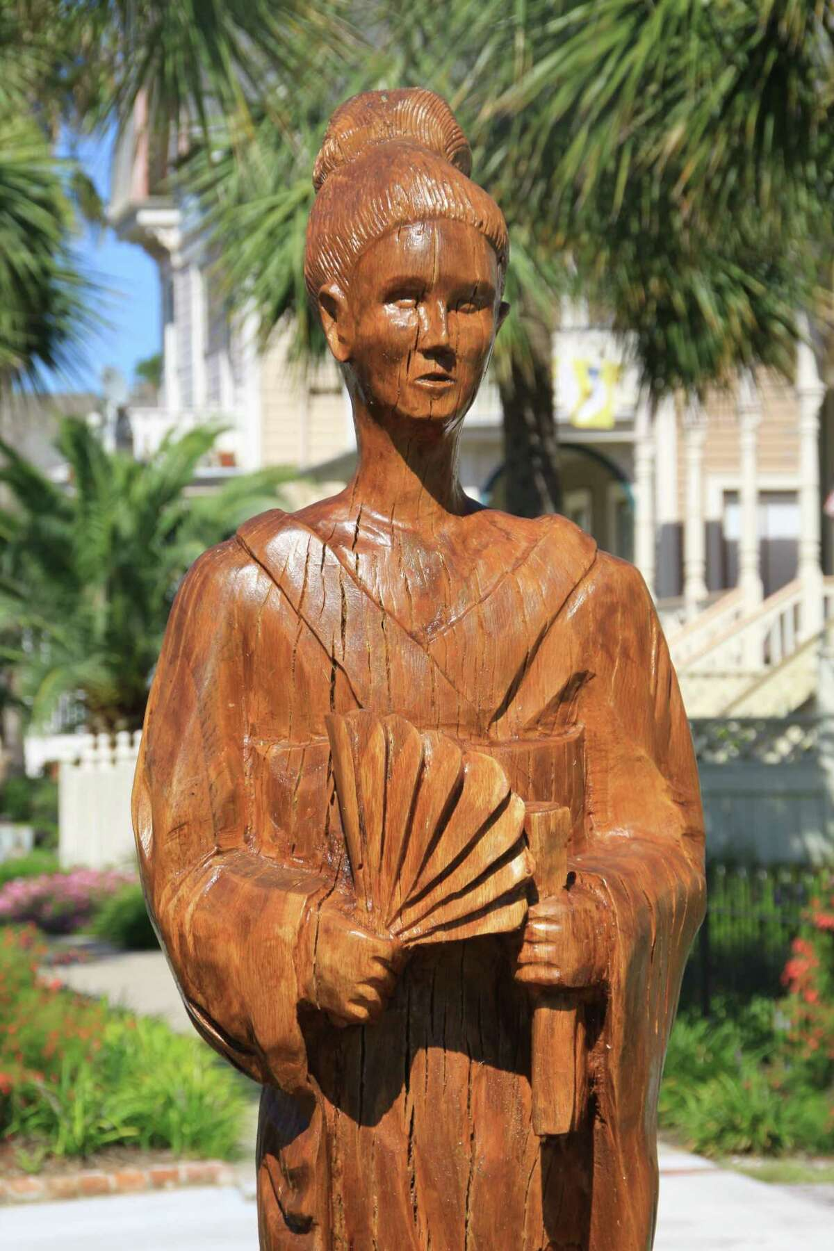 A sculpture of a geisha was created from a tree destroyed in 2008 by Hurricane Ike in Galveston.