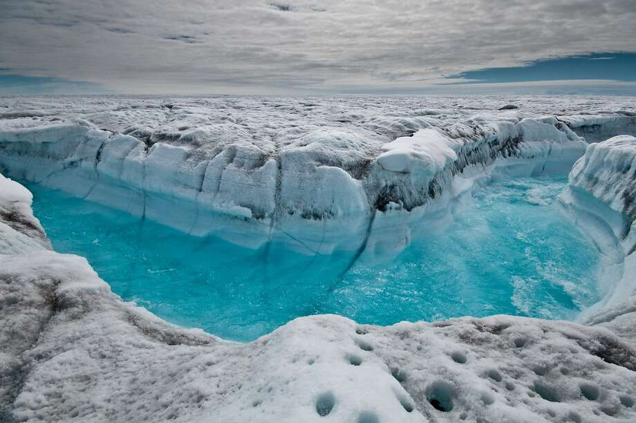 Surface melt water rushes along the Greenland Ice Sheet. Its loss could raise the sea level by 23 feet. Photo: Ian Joughin, Associated Press