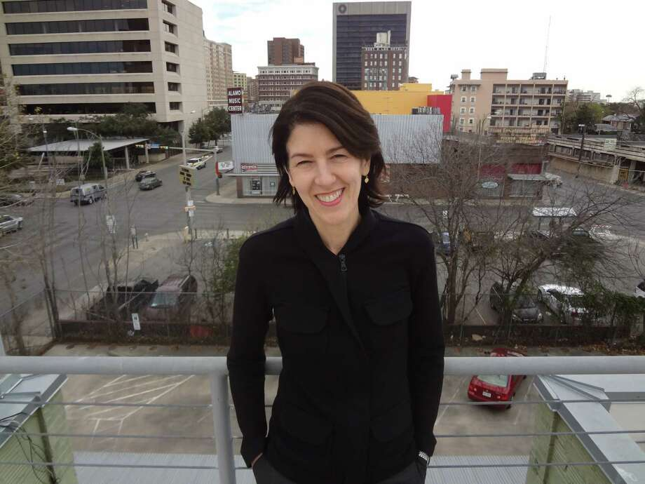 Artpace executive director Amada Cruz wants to increase the downtown art organization's visibility locally, including programming more events on the roof of the former car dealership. Photo: Steve Bennett / San Antonio Express-News