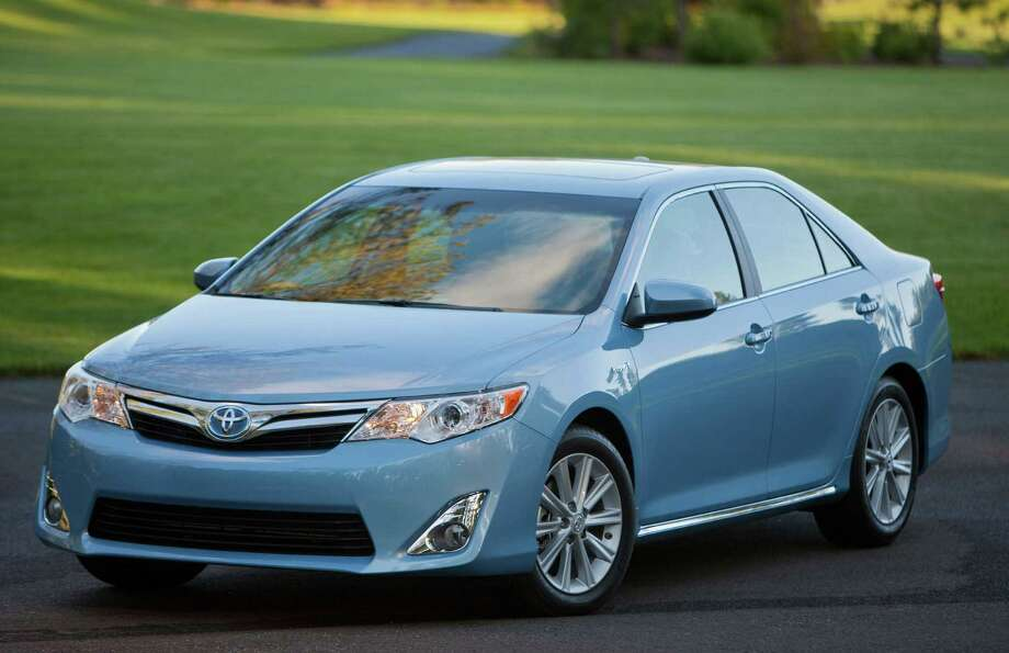 The 2013 Toyota Camry Hybrid, which starts at $26,140, has plenty of power, making it a pleasant car to drive. The midsize hybrid sedan, which is lighter and more aerodynamic than the previous generation, has EPA ratings as high as 43 mpg in the city. Photo: Photos By Toyota Motor Sales U.S.A.