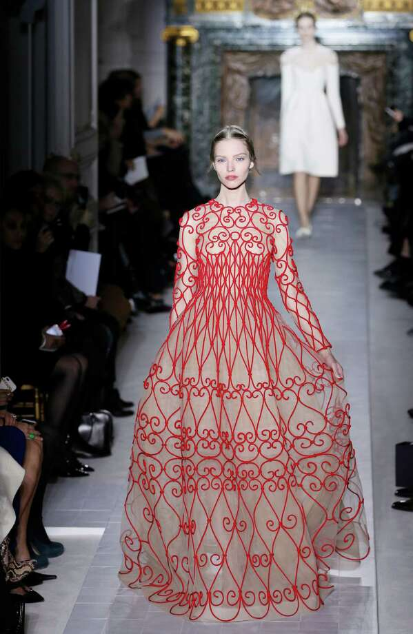 No one does red like Valentino. This spring haute couture gown recalls the swirling artistry of the Art Nouveau era in France, and its craftsmanship is unparalleled; price upon request, by special order at Valentino in the Galleria.  A model presents a creation for Valentino during the Haute Couture Spring-Summer 2013 collection shows on January 23, 2013 in Paris.   (PATRICK KOVARIK/Getty Images) Photo: PATRICK KOVARIK, Staff / AFP