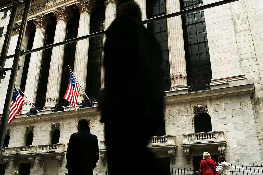 The New York Stock Exchange is seeing big gains, but the nation's overall economy has failed to keep pace with the rising markets. Photo: Spencer Platt, Getty Images