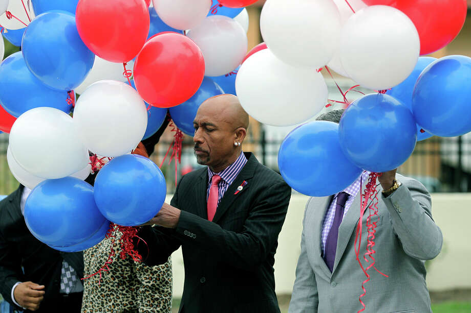 Montel Williams gets ready to release balloons at the dedication of a new Fisher House at 7485 Wurzbach Road in the South Texas Medical Center on  March 27, 2013. Photo: TOM REEL