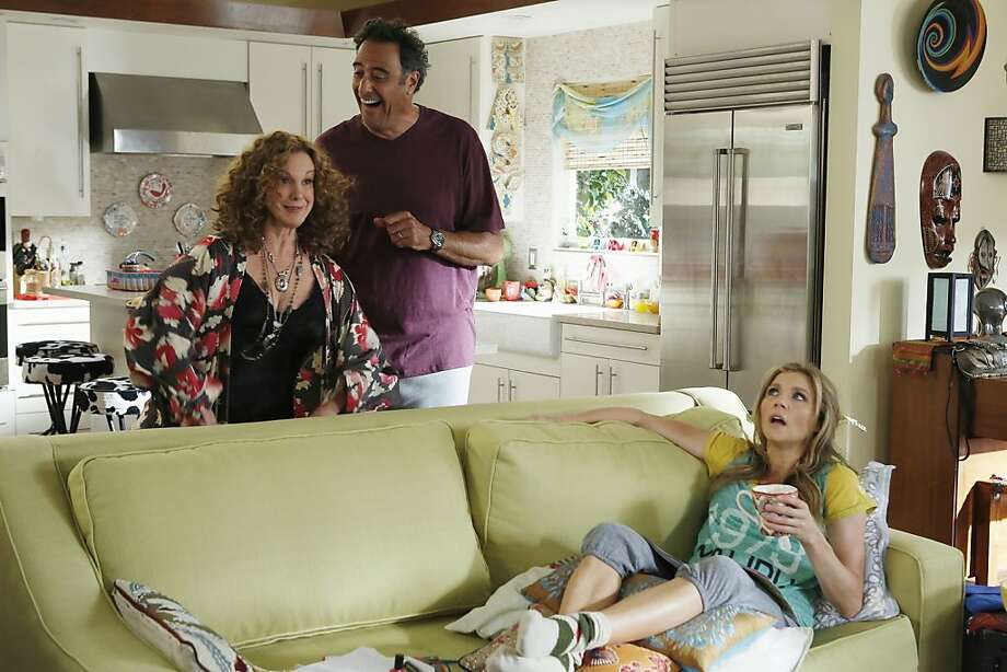 """How to Live With Your Parents"" features Sarah Chalke (on couch), mom Elizabeth Perkins and stepdad Brad Garrett. Photo: Jordin Althaus, ABC"