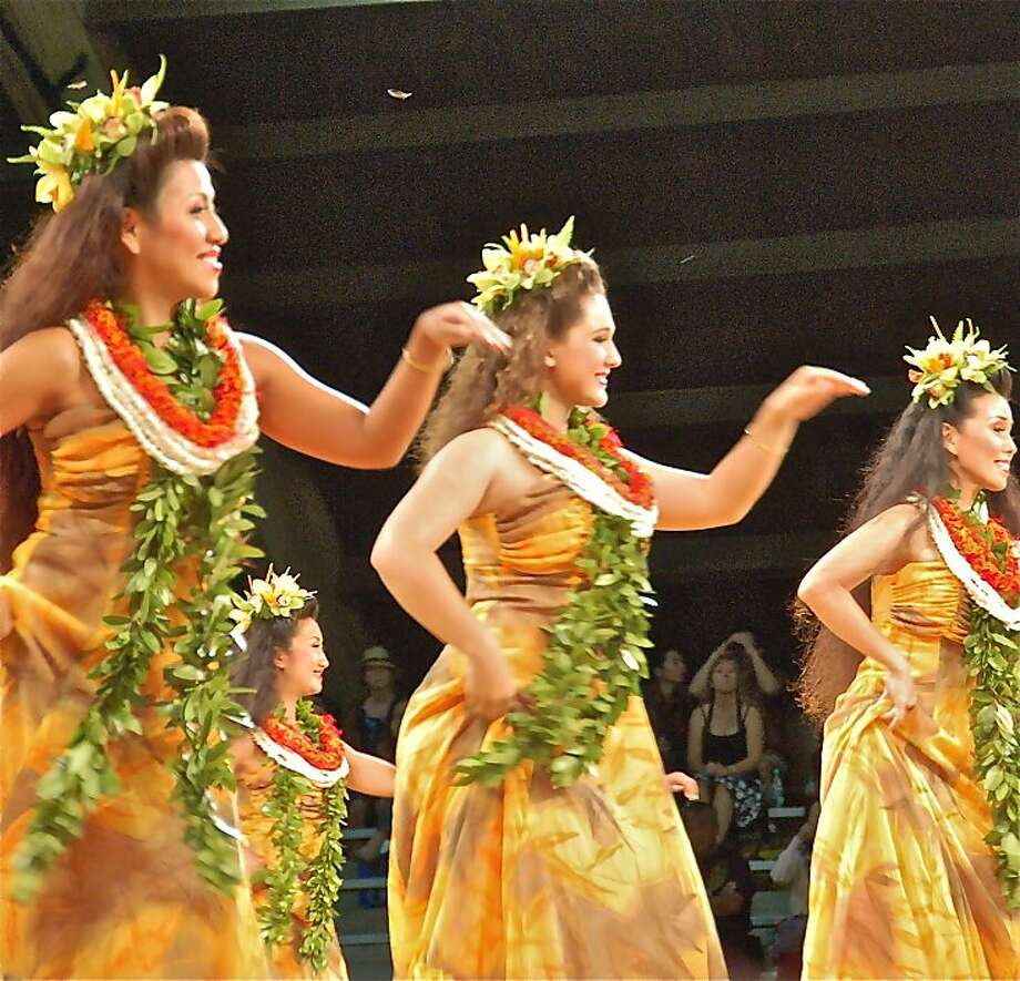 "Dancers are scored on their ability to perform in unison while still expressing individual personality, as in Keolalaulani's 2011 performance of ""Ku'uipo Onaona."" The annual Merrie Monarch Festival, which takes place in Hilo, Hawaii, runs from March 31-April 6 this year. Photo: Jeanne Cooper, SFGate"