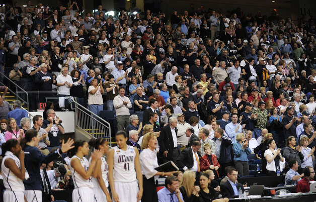 UConn fans rise to their feet in the final moments of their team's victory over Kansas State during last year's NCAA women's basketball tournament at the Webster Bank Arena in Bridgeport on Monday, March 19, 2012. Photo: Brian A. Pounds / Connecticut Post