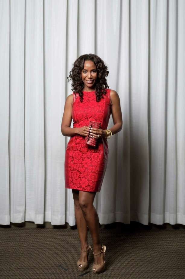 Tiffany Avery Smith in Valentino Photo: Michael Paulsen, Staff / © 2013 Houston Chronicle