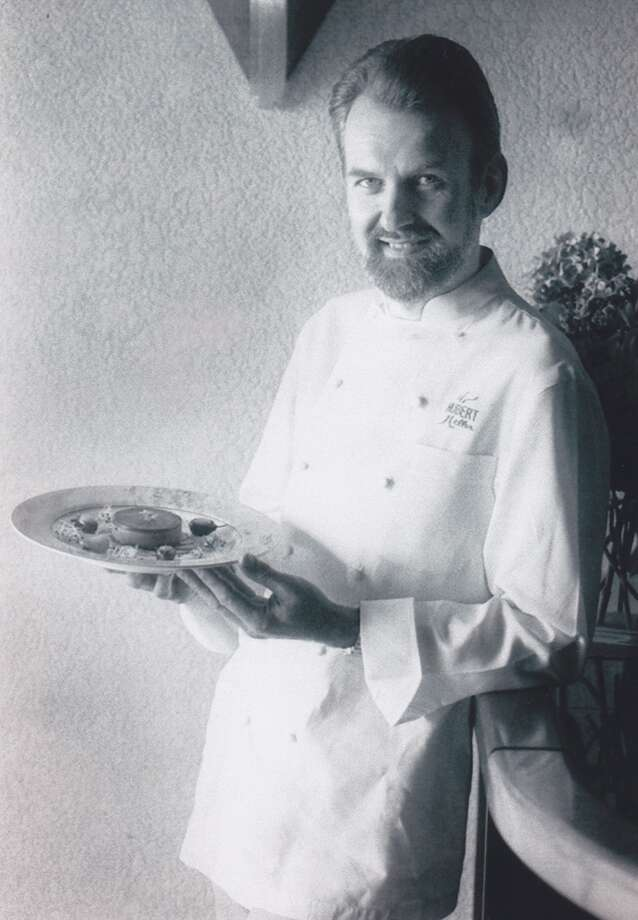 Hubert Keller gives his sexy seduction look while holding a plate of lentils, 1993