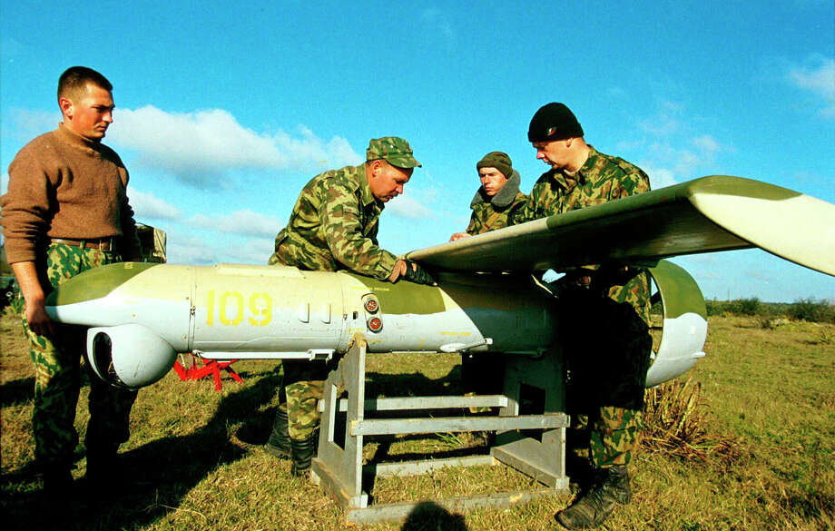 Russian army soldiers prepare a pilotless drone aircraft at a secret base near the Chechen capital Grozny in 1999. The Russians used drones to search for Chechen rebel positions. Photo: Mark H. Milstein, Getty Images / Getty Images North America